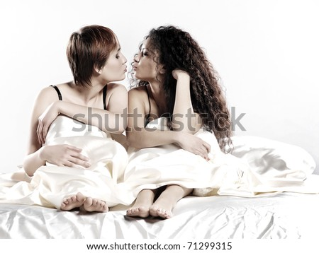 Two girls in a bed - stock photo