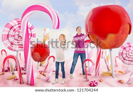 Two girls in a Candy land - stock photo