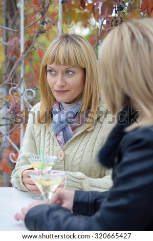 two girls in cafe/ Two  girls sitting in urban cafe and talking.