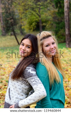 Two girls in nature - stock photo