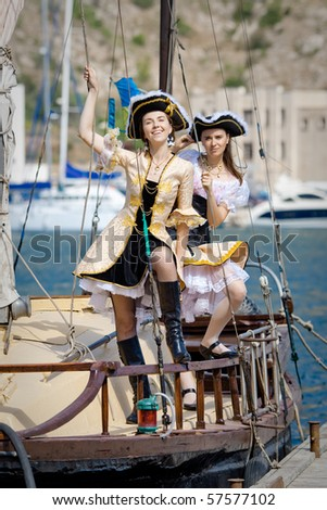 Two girls in pirate costumes outdoors - stock photo