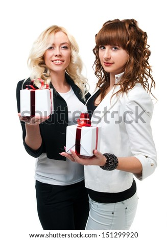 two girls in suits give wrapped gifts - stock photo