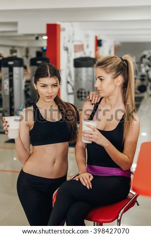 Two girls in the gym - stock photo