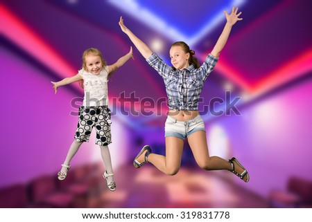 Two girls jumping - stock photo