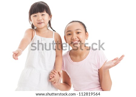 Two girls looking amused or excited about something off the screen - stock photo