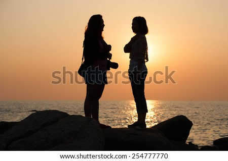 Two girls looking each other angry - stock photo