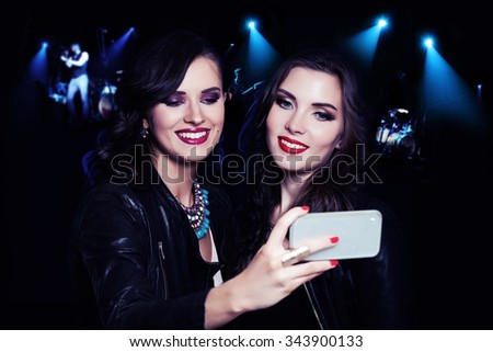 Two Girls Making Selfie on Music Party Background. Women Relaxing and Making Selfie