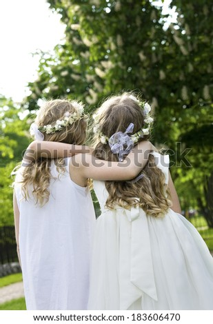 Two girls on the walk - First Communion - stock photo