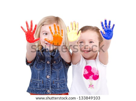 Two girls or children with paint on their hands on an isolated white background