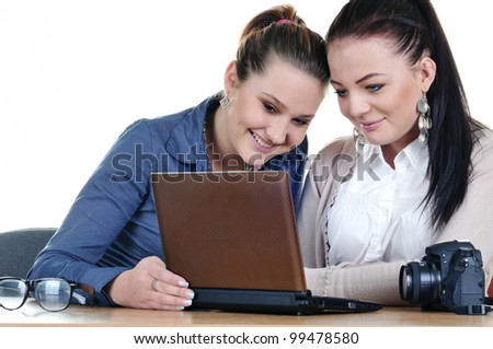 Two girls photographer looking for a netbook photos