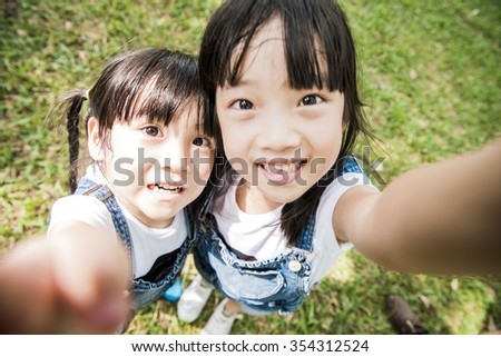 Two girls play in park