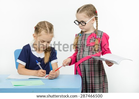 Two girls play school teacher and student - stock photo