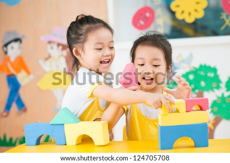 Two girls playing in the studio - stock photo