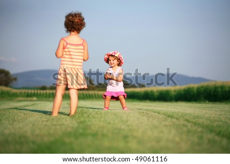Two girls playing with ball