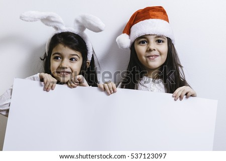 Two girls posing for Christmas and New Year holidays