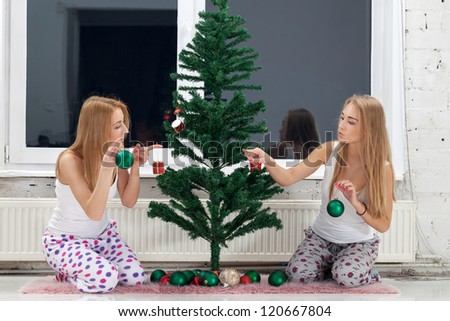 Two girls preparing for winter holidays