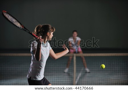 two girls recreating tennis sport - stock photo
