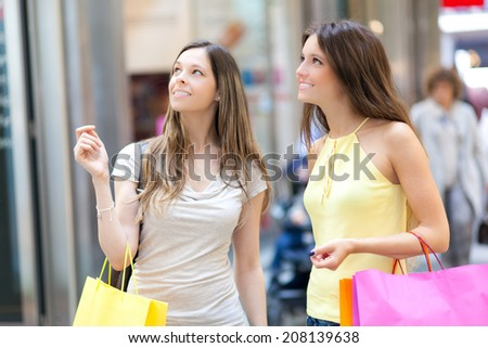 Two girls shopping outdoor in the city