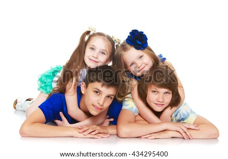 Two girls sisters hugging his neck his older brothers who lie on the floor. Only 4 people-Isolated on white background