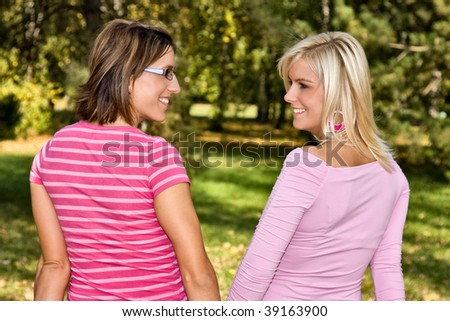 two girls smiling - stock photo