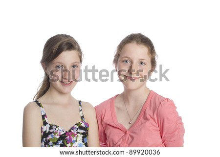 Two Girls smiling at camera. Room for text.