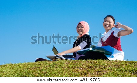 two girls study happily - stock photo