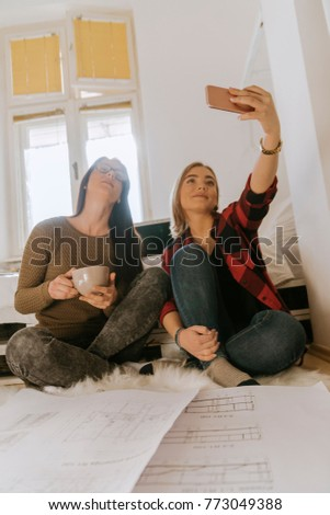 Two Girls Taking A Selfie In The Bedroom