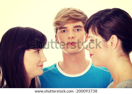 Two girls talking gossip about boy. - stock photo