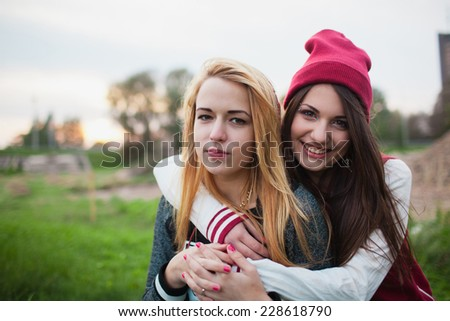 two girls teens posing outdoor - stock photo