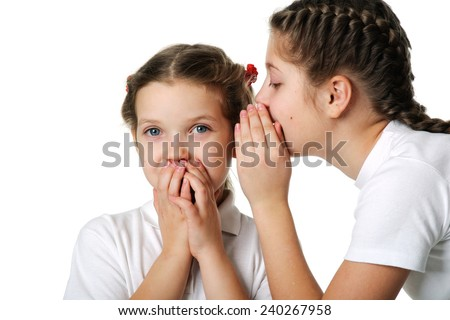 Two girls telling a secret and expressing surprise. - stock photo
