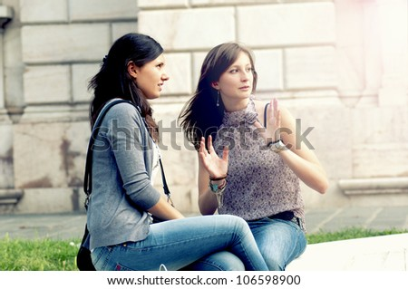 Two Girls While They Speak after to Have Made a Shopping