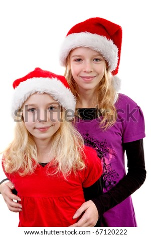 Two girls with christmas hat over white background