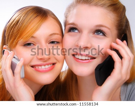 Two girls with mobiles - stock photo