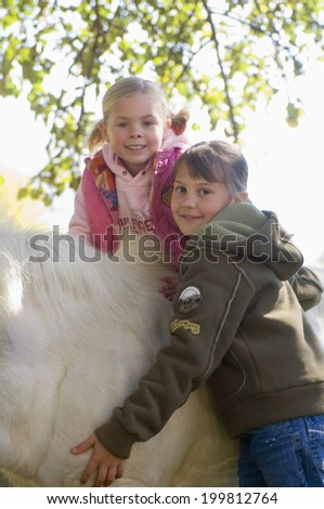 Two girls with pony - stock photo