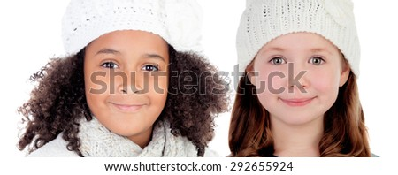 Two girls with wool cap isolated on white background - stock photo