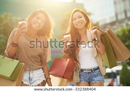 Two glamorous Asian women shopping together - stock photo