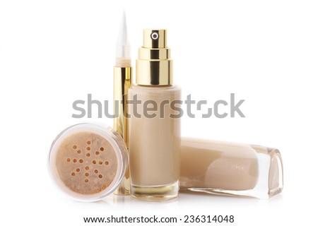 Two glass bottle of cosmetic liquid foundation, corrective concealer and loose mineral face powder isolated on white background. - stock photo