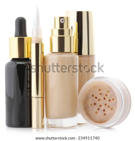 Two glass bottle of liquid foundation, corrective concealer, loose mineral powder and face serum isolated on white background. - stock photo