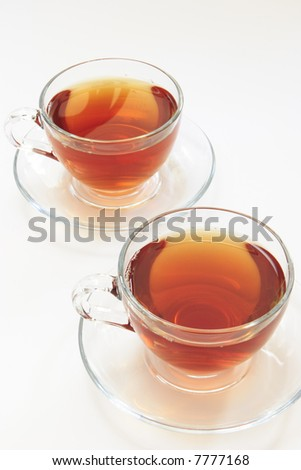 Two glass cups with hot tea