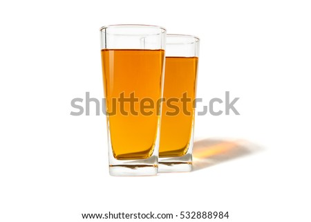 Two glass of apple juice on a white background