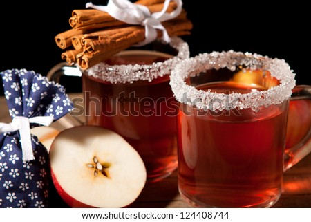 Two glass of mulled wine and apple - stock photo
