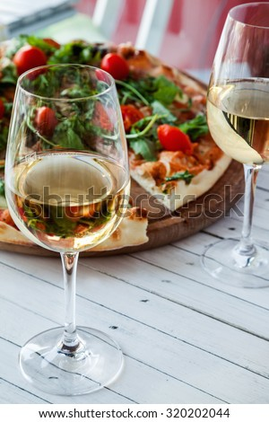 Two Glass Of White Wine And Pizza On Wooden Board