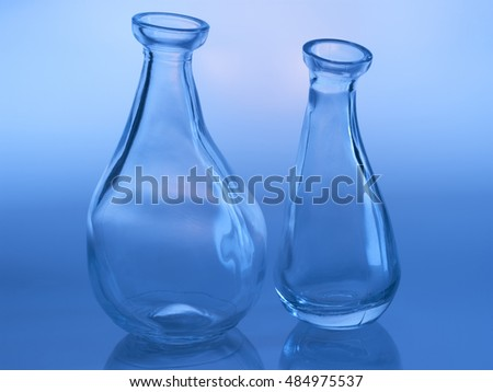 two glass vases free style art design on blue background