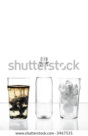 two glasses and a bottle filled with ice, water and oil - stock photo