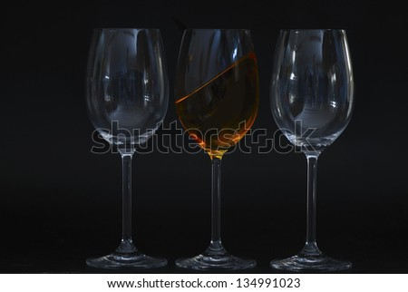 two glasses blank with yellow oblique colored liquid