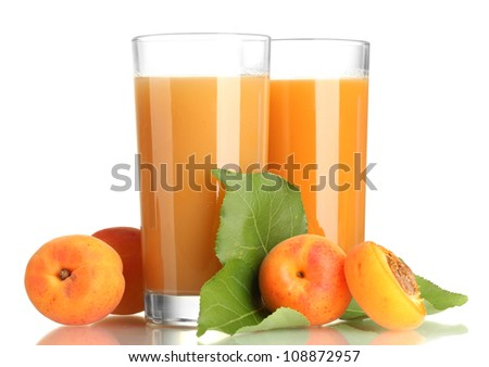two glasses of apricot juice and apricots with leaves isolated on white
