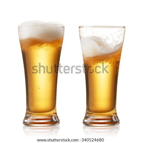 two glasses of beer isolated on white - stock photo