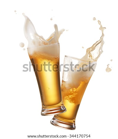 two glasses of beer toasting creating splash - stock photo