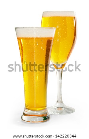 two glasses of blond beer with white bottom - stock photo