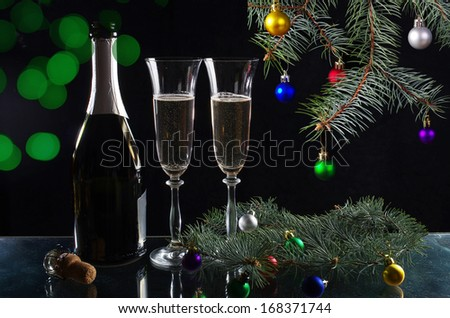 Two glasses of champagne and bottle on the festive background - stock photo